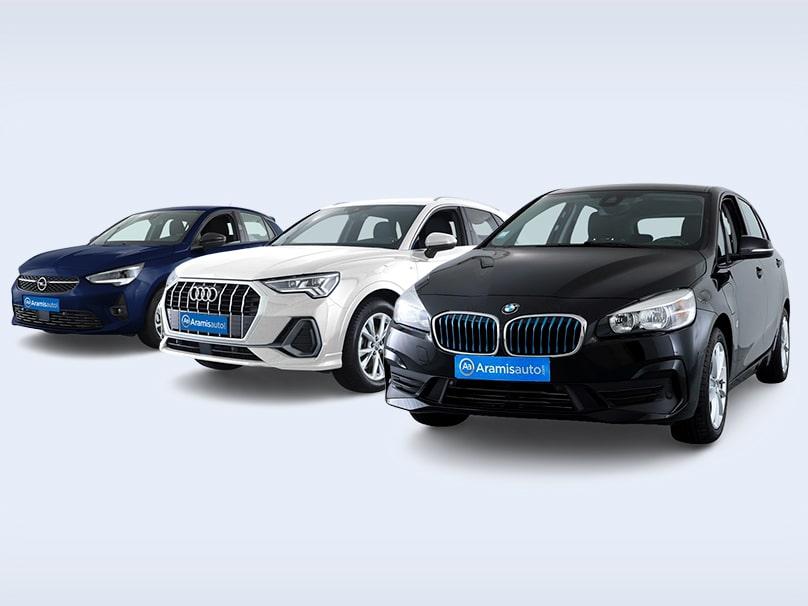 Trois voitures allemandes parmi les plus fiables mises côte-à-côte : une Opel, une Audi et une BMW.